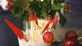 chillies : Bucket with chilli and wooden sticks for food with background of chef florists work