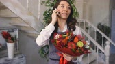 roma : Chef woman florist call phone to her clients with floral and fruit mixed bouquet