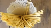 cinnamon sticks : Closeup slow motion of human hand put wooden sticks for food and canape in bucket