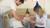 сын : Father of happy family celebrating birthday present gift to his son at home