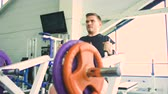 proteína : Handsome sporty man is exercising in fitness club and gym center