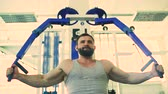 güç : Handsome sporty man is exercising in fitness club and gym center