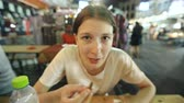 verme : Closeup of tourist woman eat snack of silkworm larva in street food asian restaunt Vídeos