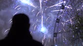 fişekçilik : Slowmotion of closeup silhouette of alone man watching fireworks on new year celebration outdoors