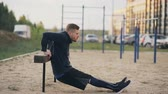 бицепс : Handsome muscular young man have workout training at the park Стоковые видеозаписи