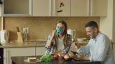 свадьба : Attractive couple chatting and having breakfast in the kitchen