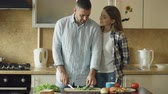 женат : Happy young couple in the kitchen. Handsome man meet and feed his girlfriend early morning