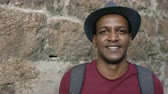 Řím : Portriat of happy african tourist man backpacker smiling and looking into camera. Mixed race young guy travelling in Europe