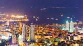 zoom out : Zoom out timelapse rooftop view of Bosphorus and Istanbul cityscape and Golden horn at night Stock Footage