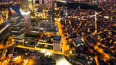 turco : Pan shot timelapse rooftop view of Istanbul cityscape and business district at night Vídeos