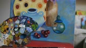 tuval : Tilt up of beautiful still life painting on canvas in art studio Stok Video