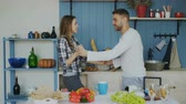 sedutor : Cheerful and attractive young couple in love dancing together latin dance in the kitchen at home on holidays Stock Footage