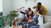 diverse : Group of joyful friends taking selfie photos on smartphone camera while celebrating at party with beer and snacks at home indoors Stock Footage