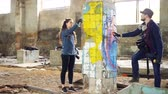 görüntüleri : Slow motion of creative graffiti painters partners decorating abandoned house with beautiful images using bright aerosol paint. Teamwork, young people and art concept.