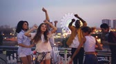 gondatlan : Slow motion of late rooftop party with joyful people dancing enjoying themselves and male deejay mixing modern music with professional equipment.