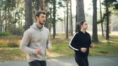 desafio : Energetic young people students are jogging in park together concentrated on practice on sunny autumn day. Active lifestyle, healthy youth and sportswear concept.