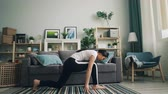 formazione personale : Flexible Asian girl is doing stretching exercises at home practising yoga poses alone improving her health and caring for her body. People and sports concept.