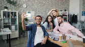 zakenvrouw : Creative businessman handsome hipster is taking selfie with young business team in modern office using smartphone camera. Modern technology and photo concept.