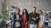 femme arabe : Portrait of attractive young people creative business team standing in officetogether and smiling looking at camera. Teamwork, youth and company concept.