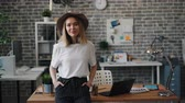 kapsa : Portrait of confident female entrepreneur blond young lady standing in office alone smiling and looking at camera. Business people and workspace concept. Dostupné videozáznamy