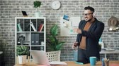 игривый : Careless office worker bearded guy in glasses is dancing listening to music throwing papers and notebook having fun. People, entertainment and happiness concept.