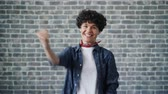 fäuste : Portrait of excited young woman raising fists celebrating success and luck expressing positive emotions. Successful people, happiness and excitement concept.
