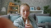 POV portrait of teenager sick girl talking to doctor online showing medication looking at camera asking professional advice. Consultation and health concept.
