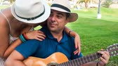 sweet couple with guitar kissing under the hats Vídeos