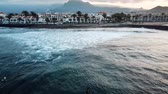 group of surfers from the aerial view, waiting to enjoy the waves at the sunrise. Early morning in las Americas in Tenerife Vídeos