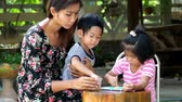 mother teach kid play game joyfully, family play game together
