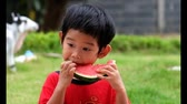 melão : cute kid Enjoying Slices Of Water Melon, a little boy enjoy eating water melon