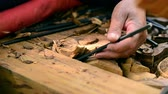 Close up wood carver working