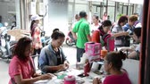 CHANTHABURI PROVINCE,THAILAND-NOVEMBER 8: People consists of people from many countries like Thailand, China, Africa, Pakistan, to trade gems at Chanthaburi Gems market place on NOVEMBER 8, 2014. 影像素材