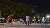 UBON RATCHATHANI,THAILAND-NOVEMBER 2: People in city are aerobic dance together in Thong Sri Muang public park on NOVEMBER 2, 2014.