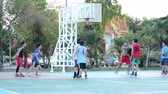UBON RATCHATHANI,THAILAND-NOVEMBER 2: People in city playing basketball game in Thong Sri Muang public park on NOVEMBER 2, 2014.