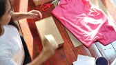 Online seller business woman packing product for sending to customer