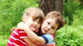 brother : Happy little boy and girl embrace in summer forest