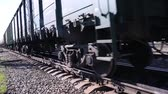 sleepers : Close up of wheels of train going by railway on summer day Stock Footage