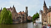 Bruges Belgium  May 11 2015: Bruges Belfry seen from Rozenhoedkaai in Bruges Belgium. Time Lapse Video.