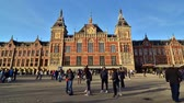 Amsterdam Netherlands  May 7 2015: People at Amsterdam Central Station on May 7 2015. The Station opened in 1889 and is located in the heart of the city.