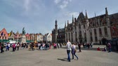 Bruges Belgium  May 11 2015: Tourist on Grote Markt square in Bruges Belgium on May 11 2015. The historic city centre is a prominent World Heritage Site of UNESCO.