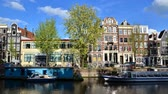 Amsterdam, Netherlands - May 7, 2015: Traditional houses of Amsterdam with canal in Amsterdam, Netherlands
