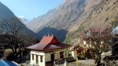 Buddhist monastery in remote village surrounded by Himalayas Стоковые видеозаписи