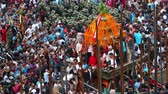 bohyně : Kathmandu, Nepal - September 13 2019: People pulling chariot of Kumari Goddess through the crowd. Dostupné videozáznamy