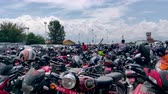 припаркован : Kathmandu, Nepal - September 21 2019:  Motorcycles parked at an airport parking space. Стоковые видеозаписи