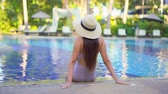 charismatic : Women around swimming pool in resort for relax in vacation