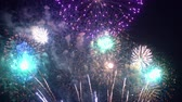 kitörés : Beautiful abstract colourful Fireworks explode display on sky at night a symbol of celebration in New years anniversary for background
