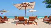 sessel : Umbrella and chair on the tropical beach and sea with white cloud blue sky for travel Videos