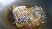 kitchen : Fried fish in a frying pan close up