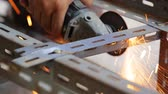 men : unidentify worker grinding metal construction with a circular saw Stock Footage